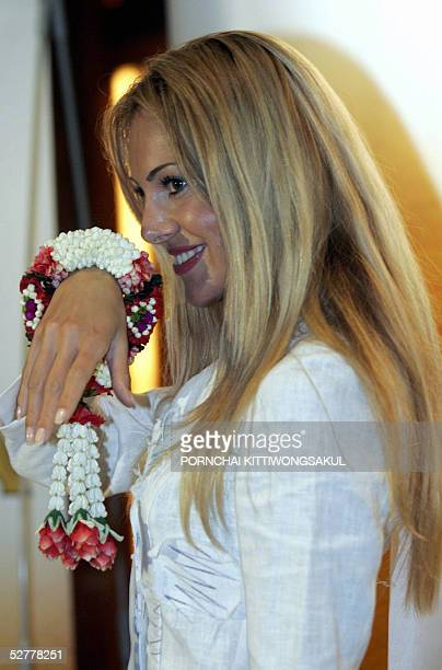 Miss Serbia Montenegro Jelena Mandic poses for photographers with a garland upon arrival at a local hotel in Bangkok 09 May 2005 Contestants for the...