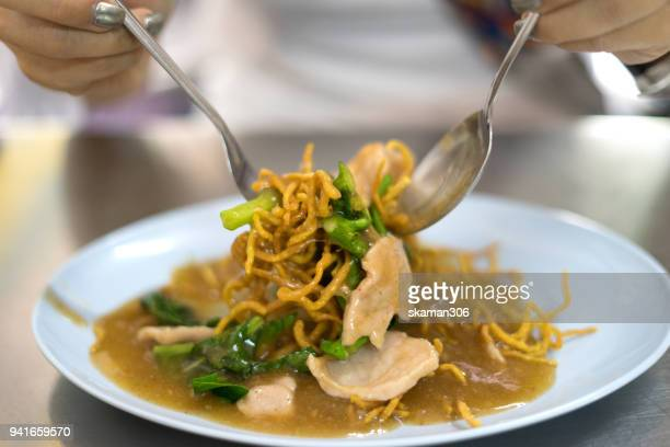 Thailand Noodle soup with pork and chilli