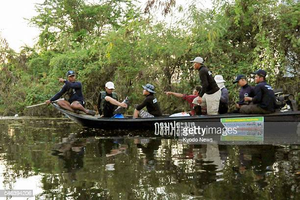 BANGBUATONG Thailand People on a boat search for crocodiles in the floodhit Bangbuatong district in Nonthaburi Province central Thailand on Nov 1...