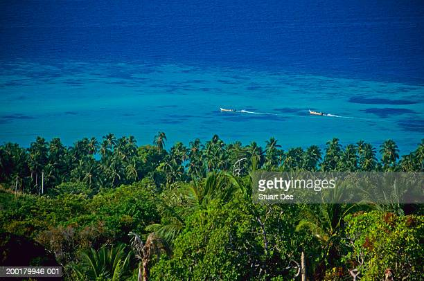 thailand, phi phi island, boats in background, elevated view - travel14 stock pictures, royalty-free photos & images