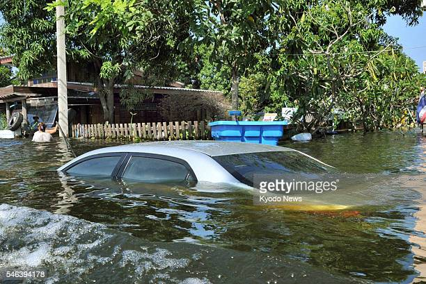 BANGBUATONG Thailand Photo shows a submerged car in the floodhit Bangbuatong district in Nonthaburi Province central Thailand on Nov 1 2011