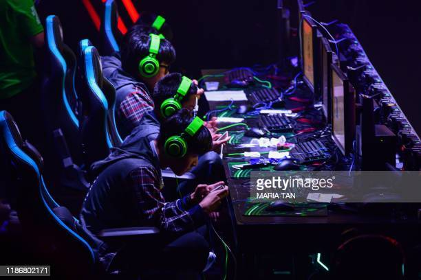 Thailand players focus during their game against Myanmar for the eSports Mobile Legends Bang Bang matches at the 30th SEA Games in Manila on December...