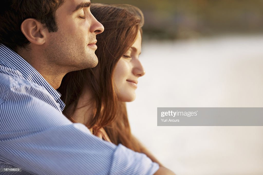 Thailand, Portrait of couple hugging on beach : Stock Photo