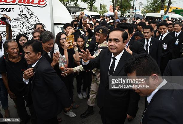 Thailand Prime Minister Prayut ChanOCha walks through Sanam Luang park where people have been gathering in large numbers to pay respects to the late...
