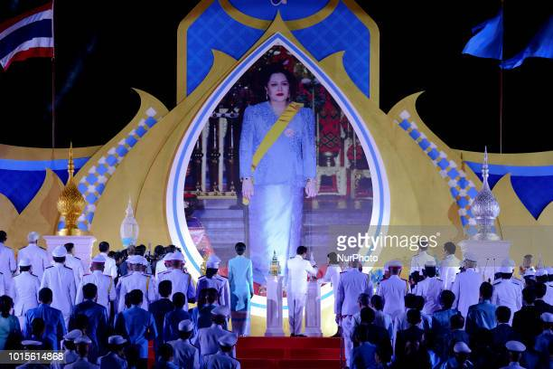 Thailand Prime Minister Prayuth Chanocha joins other wellwishers holding candles to celebrate the Queens Sirikit' 86th birthday in Bangkok Thailand...