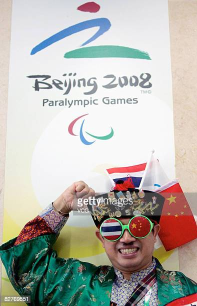 A Thailand reporter is seen wearing Thailand and Chinese national flags during day four of the 2008 Paralympic Games on September 10 2008 in Beijing...