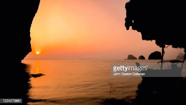 thailand, sunrise in phang nga bay - インド洋 ストックフォトと画像