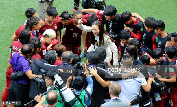 Thailand Team Manager, Nualphan Lamsam, gives instructions to the Thailand players in a team huddle prior to the 2019 FIFA Women's World Cup France...