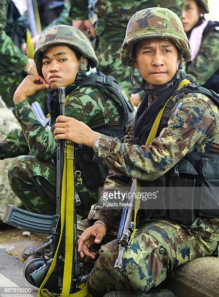 BANGKOK Thailand Thai soldiers keep guard in Bangkok on May 23 a day after a coup d'etat in which the military ousted the caretaker government