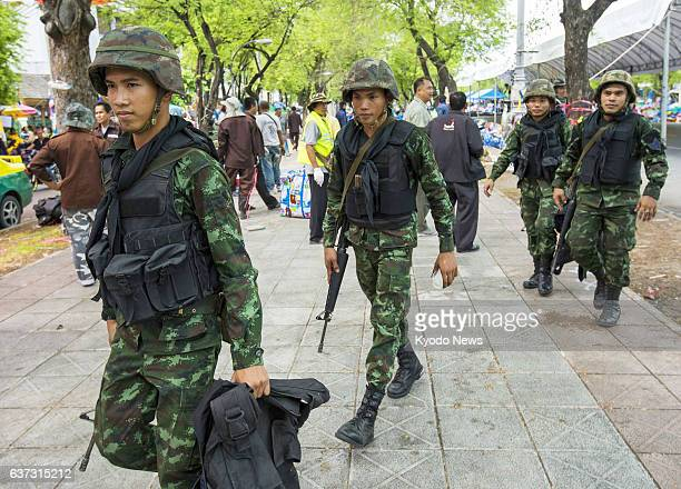 BANGKOK Thailand Thai soldiers patrol an area in Bangkok that has been used by antigovernment protesters as a stronghold of their activities as the...