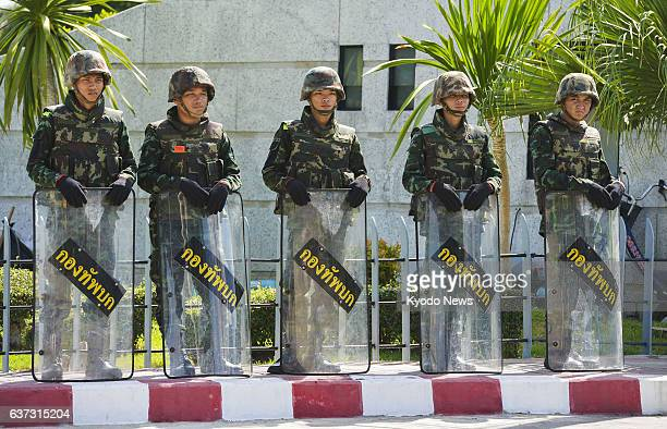 BANGKOK Thailand Thai soldiers stand guard at a military facility in Bangkok on May 23 a day after a coup d'etat in which the military ousted the...