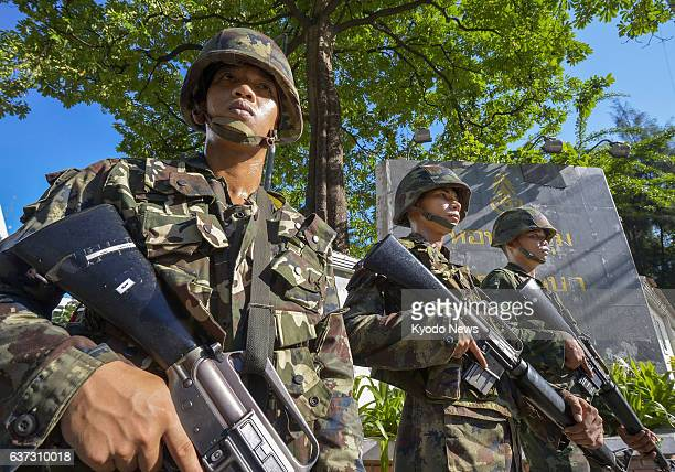 BANGKOK Thailand Thai soldiers stand guard in front of a military facility in Bangkok on May 23 a day after the military staged a coup ousting the...