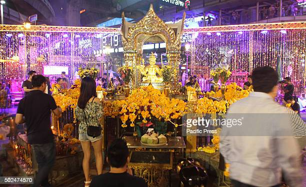 Thailand tourists and foreigners pray at the Erawan Shrine Ratchaprasong during the welcome ceremony of Festival Christmas and New year 2016.