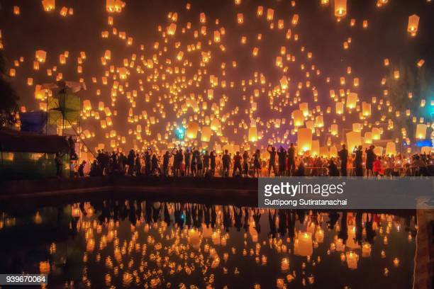 thailand traditional culture sky lanterns firework festival, chiang mai, thailand, loy krathong and yi peng festival - chiang mai province stock photos and pictures