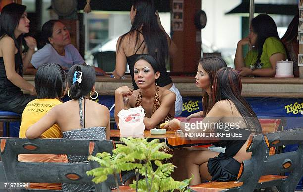 WITH ThailandcouptourismPattayasched Thais sit outside a bar in Pattaya some 150 kms east of the Thai capital Bangkok 22 September 2006 Millions of...