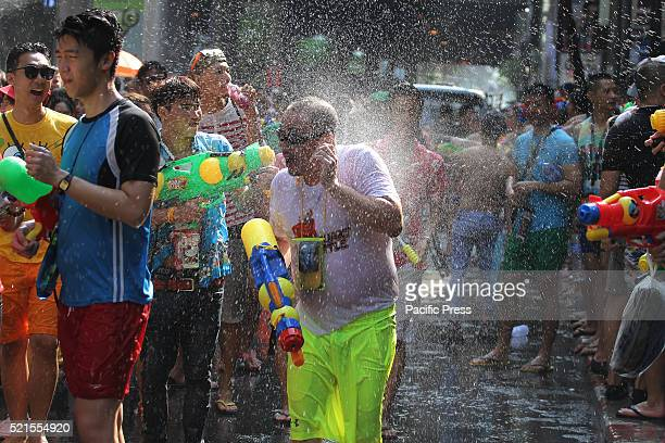 Thailanders and tourists take part in a water fight during the Songkran water festival in Silom Road The final day of the Songkran Festival this year...