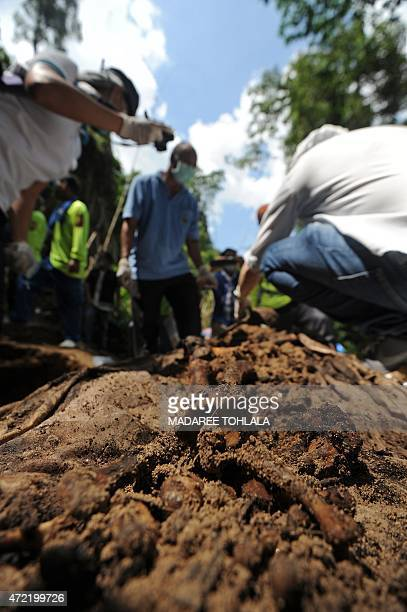 ThailandMyanmarBangladeshMalaysiamigrationminorityFOCUS by Jerome TAYLOR This picture taken on May 2 2015 shows rescue workers and forensic officials...