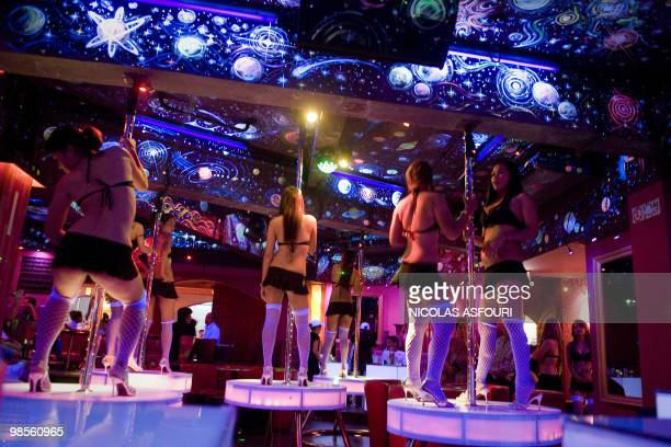 Thailandpoliticsprotestnightlife by Patrick Falby Bar girls dance inside their establishment in the Patpong 'red light' district in central Bangkok...