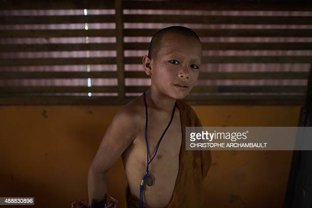 ThailandreligiondrugssocialFEATURE by Marion THIBAUT This picture taken on April 7 2015 shows Buddhist novice Chaiyo Saeyee posing for a picture at...