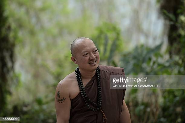ThailandreligiondrugssocialFEATURE by Marion THIBAUT This picture taken on April 8 2015 shows the head monk of the 'Temple of the Golden Horse' Pra...