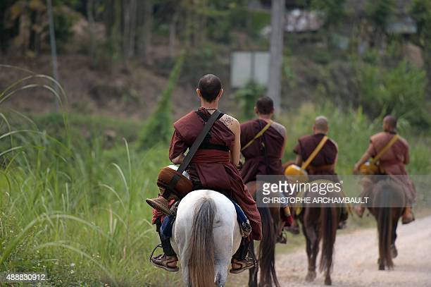 ThailandreligiondrugssocialFEATURE by Marion THIBAUT This picture taken on April 8 2015 shows Buddhist novice Ponsakorn Mayer riding a horse as he...
