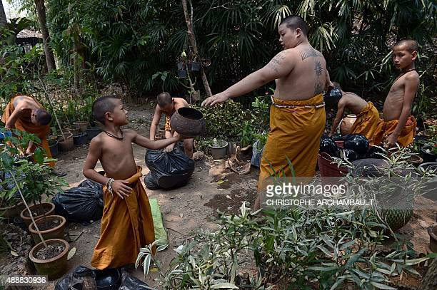 ThailandreligiondrugssocialFEATURE by Marion THIBAUT This picture taken on April 8 2015 shows Buddhist novices taking part in daily chores at the...