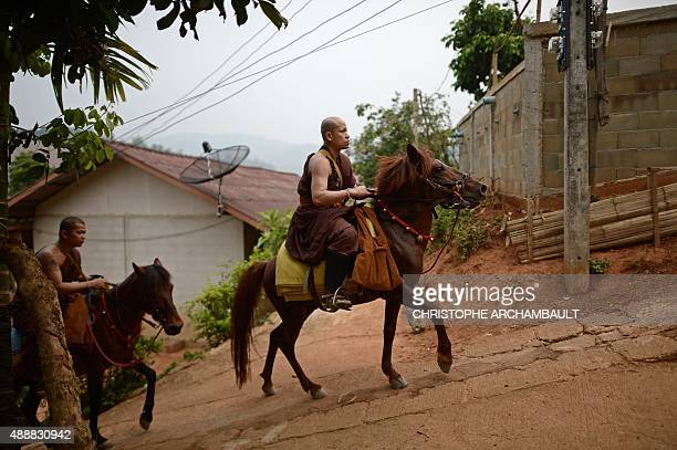 ThailandreligiondrugssocialFEATURE by Marion THIBAUT This picture taken on April 8 2015 shows monks riding horses during their early morning...