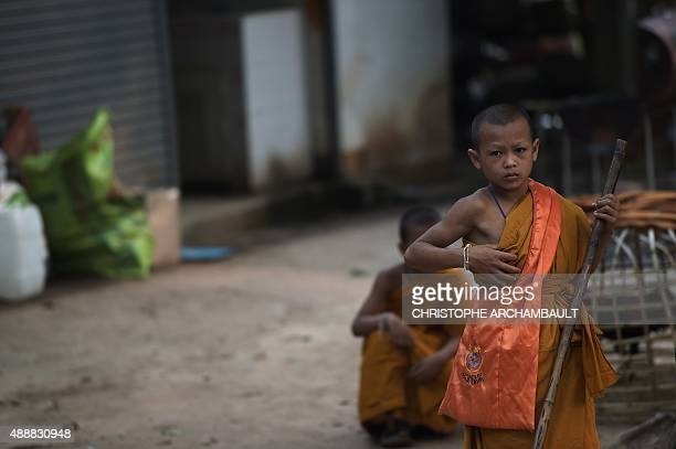 ThailandreligiondrugssocialFEATURE by Marion THIBAUT This picture taken on April 8 2015 shows Buddhist novice Chaiyo Saeyee pausing as he sweeps a...