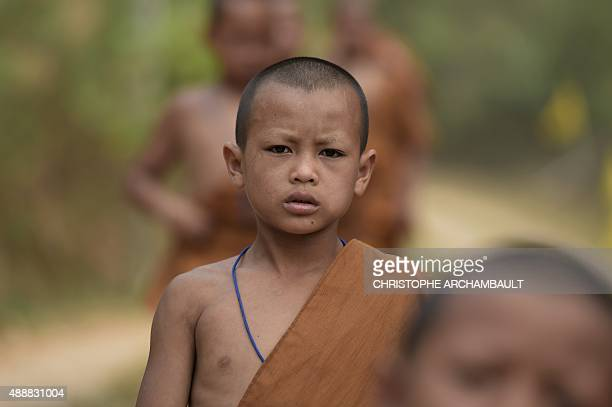 ThailandreligiondrugssocialFEATURE by Marion THIBAUT This picture taken on April 8 2015 shows Buddhist novice Chaiyo Saeyee walking with others...