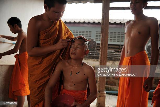 STORY Thailandreligionsocietygender by Janesara FUGAL This picture taken on June 15 2011 shows Buddhist novice monk and aspiring ladyboy Pipop...