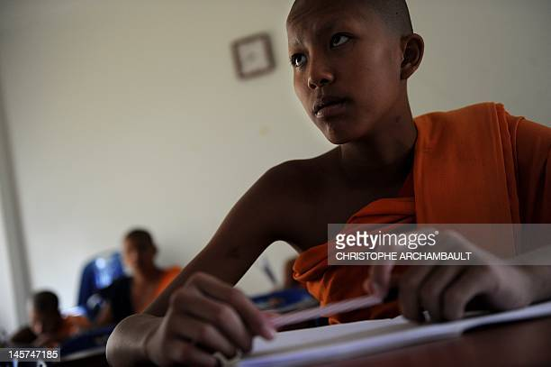 STORY Thailandreligionsocietygender by Janesara FUGAL This picture taken on June 16 2011 shows Buddhist novice monk and aspiring ladyboy Pipop...
