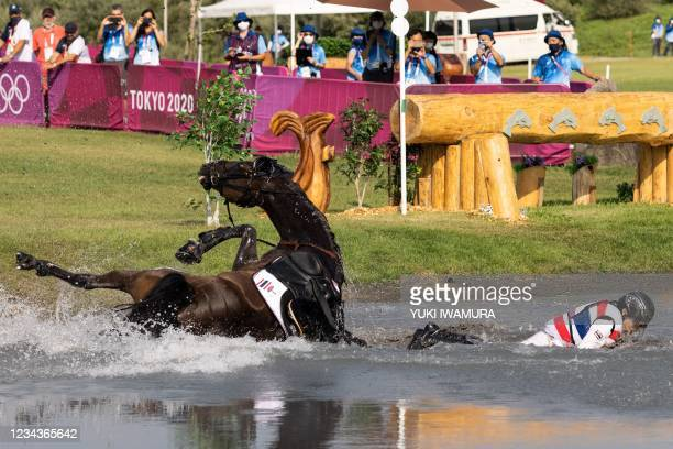 Thailand's Arinadtha Chavatanont and Boleybawn Prince fall during the equestrian's eventing team and individual cross country during the Tokyo 2020...