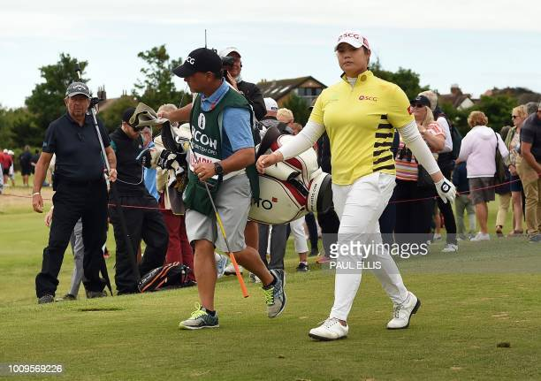 Thailand's Ariya Jatanugam leaves the fifth green on the first day of the 2018 Women's British Open Golf Championships at Royal Lytham St Annes Golf...