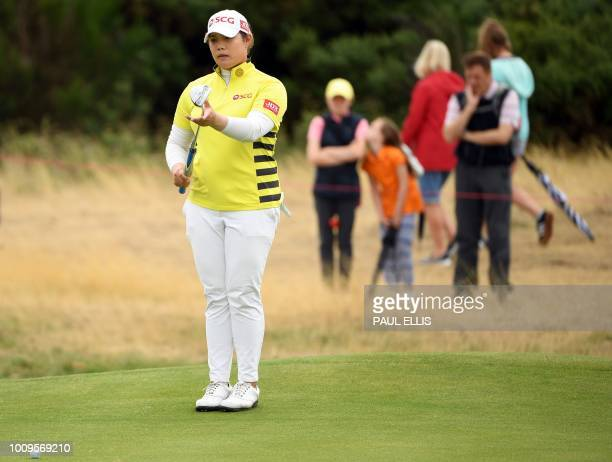 Thailand's Ariya Jatanugam putts on the 4th green on the first day of the 2018 Women's British Open Golf Championships at Royal Lytham St Annes Golf...