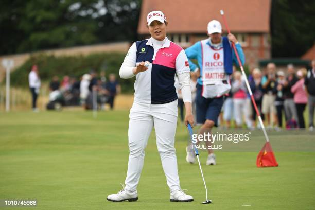 Thailand's Ariya Jutanugarn acknowledges the applause after putting on the 1st green on the third day of the 2018 Women's British Open Golf...