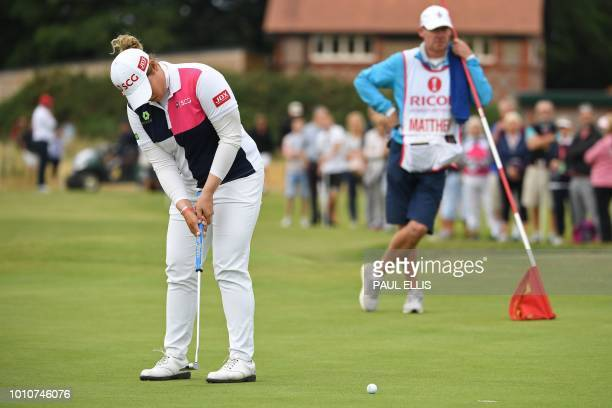 Thailand's Ariya Jutanugarn putts on the 1st green on the third day of the 2018 Women's British Open Golf Championships at Royal Lytham St Annes Golf...