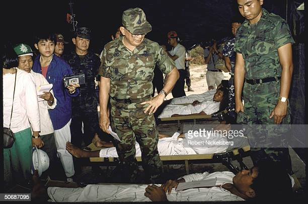 Thailand's Army ComanderinChief Chavalit with others visiting wounded soldiers