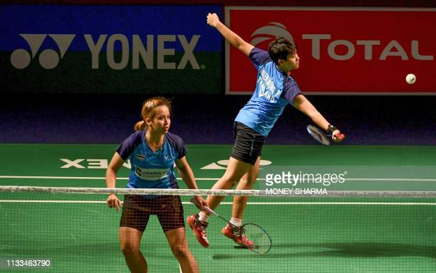 Thailand's badminton players Phataimas Muenwong and Chayanit Chaladchalam play a shot against Malaysia's badminton players Mei Kuan Chow and Meng...