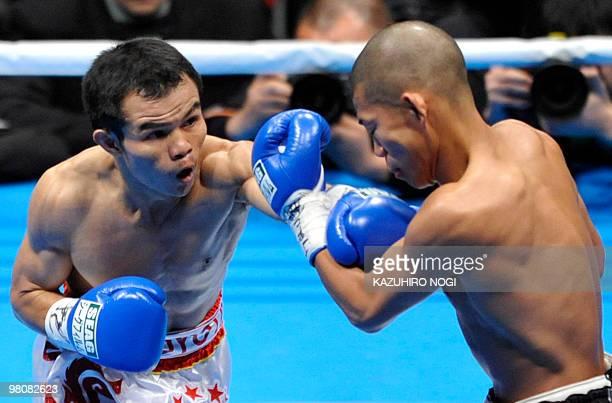 Thailand's challenger Pongsaklek Wonjogkam hits his left on Japanese champion Koki Kameda during their WBC flyweight title match at Ariake Colosseum...