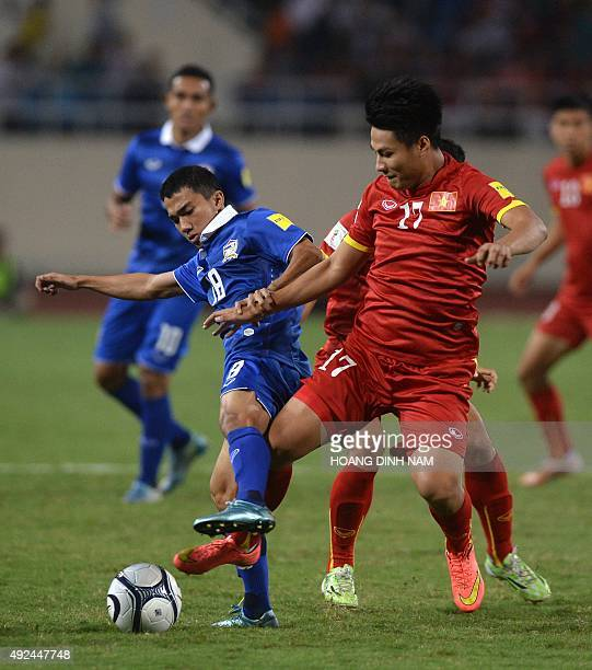 Thailand's Chanathip fights for the ball with Vietnam's Mac Hong Quan during a World Cup 2018 qualifier between Vietnam and Thailand on October 13,...