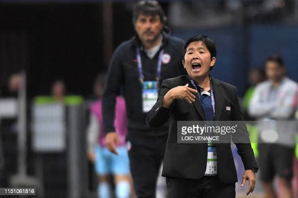 Thailand's coach Nuengrutai Srathongvian gestures during the France 2019 Women's World Cup Group F football match between Thailand and Chile on June...