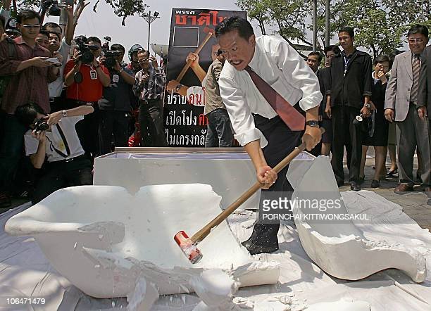 FILES Thailand's controversial lawmaker Chuvit Kamolvisit smashes his bathtub during a symbolic event to clear his image as massage parlour tycoon in...
