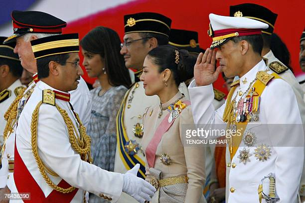 Thailand's Crown Price Maha Vajiralongkorn salutes Malaysia's King Tuanku Mizan Zainal Abidin as they greet each other on stage during Malaysia's...
