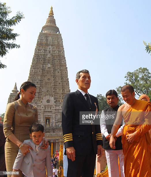 Thailand's Crown Prince Vajiralongkorn and his royal family exit after offering prayers at the world heritage Mahabodhi Temple in Bodh Gaya on...