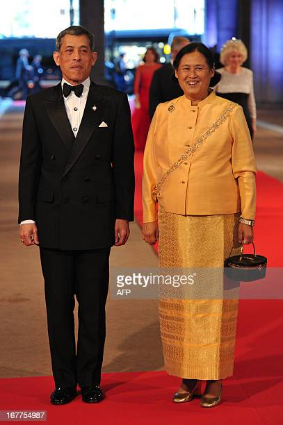 Thailand's Crown Prince Vajiralongkorn and Princess Sirindhorn arrive on April 29 2013 to attend a dinner at the National Museum in Amsterdam hosted...