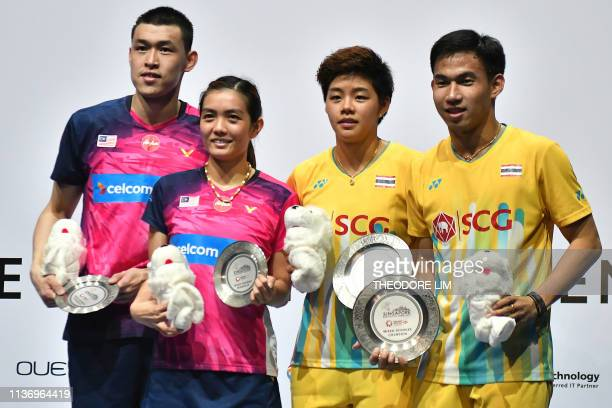 Thailand's Dechapol Puavaranukroh and Sapsiree Taerattanachai pose for photos after winning their mixed doubles finals match against Malaysia's Tan...