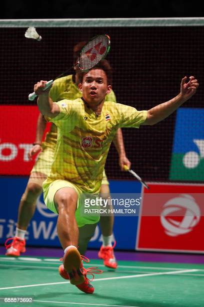 Thailand's Dechapol Puavaranukroh hits a return during the men's doubles Sudirman Cup match with Bodin Issara against Seung Jae Seo and Choi Solgyu...