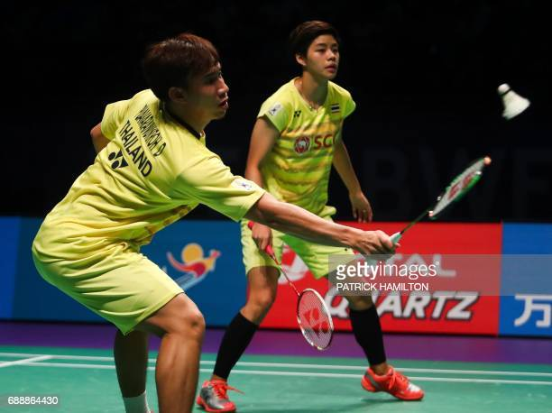 Thailand's Dechapol Puavaranukroh hits a return with partner Sapsiree Taerattanachai during the mixed doubles Sudirman Cup match against Chae Yoo...