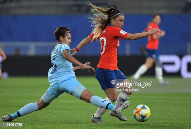 Thailand's defender Ainon Phancha vies with Chile's forward Yanara Aedo during the France 2019 Women's World Cup Group F football match between...