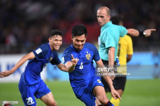 Thailand's defender Pansa Hemviboon celebrates after scoring a goal against Malaysia during the second leg of the AFF Suzuki Cup 2018 semifinal...